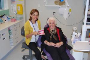 Dental hygienist Jayne Braunsteiner with Montefiore Randwick resident Cato Klien