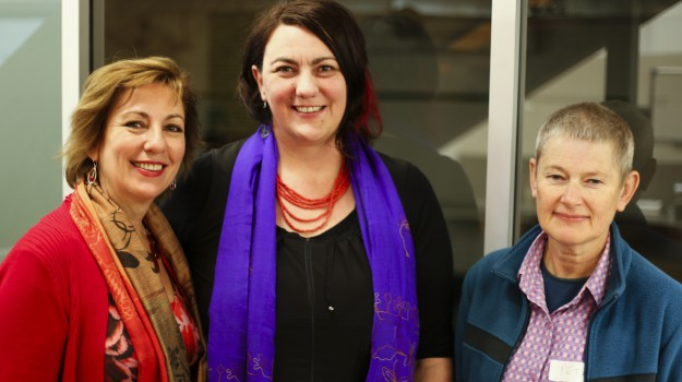 Conference MC Kate Maguire with Kerrie Noonan and Peta Murray from The Groundswell Project. Photo credit Adam Dunn, Big Shot Graffix